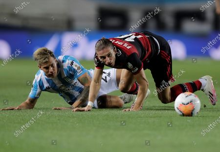 Racing's Nicolas Reniero (L) in action against Filipe Luis (R) of Flamengo during the Copa Libertadores match between Racing of Argentina and Brazilian Flamengo, at the Presidente Peron stadium, in the city of Avellaneda, in the province of Buenos Aires, Argentina, 24 November 2020.
