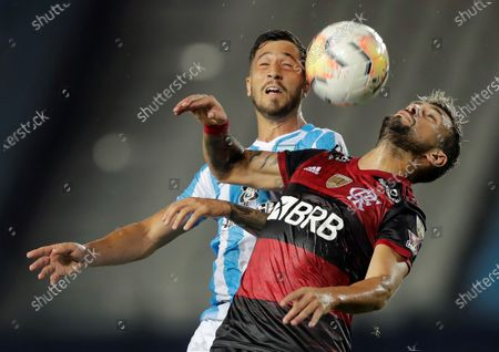 Racing's Fabricio Dominguez (L) in action against Giorgian De Arrascaeta (R) of Flamengo during the Copa Libertadores match between Racing of Argentina and Brazilian Flamengo, at the Presidente Peron stadium, in the city of Avellaneda, in the province of Buenos Aires, Argentina, 24 November 2020.