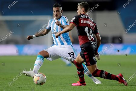 Racing's Leonel Miranda (L) vies for the ball with Giorgian De Arrascaeta (R) of Flamengo during the Copa Libertadores match between Racing of Argentina and Brazilian Flamengo, at the Presidente Peron stadium, in the city of Avellaneda, in the province of Buenos Aires, Argentina, 24 November 2020.