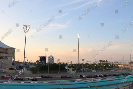 Yas Marina Circuit, Abu Dhabi, United Arab Emirates. Sunday 29 November 2015. Pastor Maldonado, Lotus E23 Mercedes, and Fernando Alonso, McLaren MP4-30 Honda, make contact at the start. World Copyright: Will Taylor-Medhurst/LAT Photographic