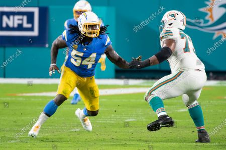 Stock Picture of Miami Dolphins tackle Austin Jackson (73) blocks Los Angeles Chargers defensive end Melvin Ingram (54) during an NFL football game, in Miami Gardens, Fla