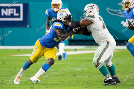 Miami Dolphins tackle Austin Jackson (73) blocks Los Angeles Chargers defensive end Melvin Ingram (54) during an NFL football game, in Miami Gardens, Fla