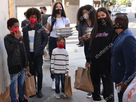 Gary Lee Liessner, Kenzo Lee Hounsou, Wolfe Lee Liessner, Kimora Lee Simmons, Aoki Lee Hounsou, and Ming Lee Simmons hand out Thanksgiving meals to homeless residents of Skid Row's Housing Trust's Star Apartments