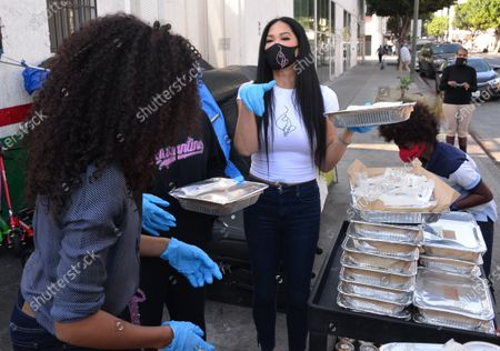 Aoki Lee Simmons, Kimora Lee Simmons and Kenzo Lee HounsouKimora Lee Simmons and Kenzo Lee Hounsou hand out Thanksgiving meals to homeless residents of Skid Row's Housing Trust's Star Apartments