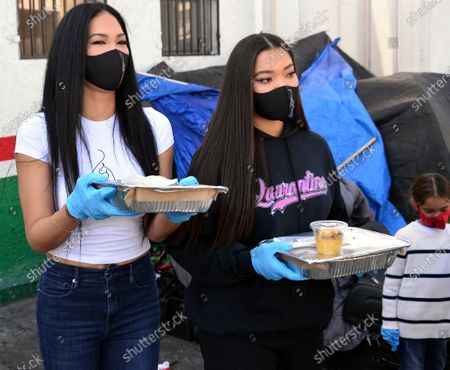 Kimora Lee Simmons and Ming Lee Simmons hand out Thanksgiving meals to homeless residents of Skid Row's Housing Trust's Star Apartments