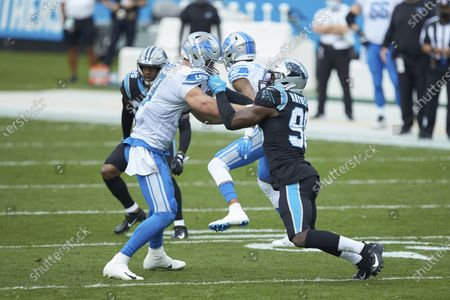 Detroit Lions tight end Jesse James (83) blocks Carolina Panthers defensive end Marquis Haynes (98) during an NFL football game, in Charlotte, N.C