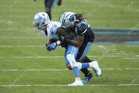 Detroit Lions wide receiver Marvin Jones Jr. (11) is tackled by Carolina Panthers linebacker Shaq Thompson (54) during an NFL football game, in Charlotte, N.C