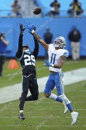Carolina Panthers cornerback Corn Elder (29) defends a pass intended for Detroit Lions wide receiver Marvin Jones Jr. (11) during an NFL football game, in Charlotte, N.C