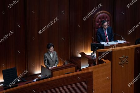Hong Kong Chief Executive Carrie Lam (L) delivers the policy address at the Legislative Council as the chairman of the Legislative Council Andrew Leung (R), looks on, in Hong Kong, China, 25 November 2020. This is Lam's fourth policy address rolling out her government's latest road map for tackling the city's mounting economic, social and political issues.