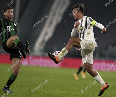 Juventus' Paulo Dybala (R) vies with Ferencvaros' Lasha Dvali during the UEFA Champions League group G match between Juventus and Ferencvaros in Turin, Italy, Nov. 24, 2020.
