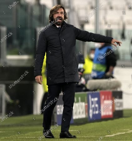 Juventus' head coach Andrea Pirlo gestures during the UEFA Champions League group G match between Juventus and Ferencvaros in Turin, Italy, Nov. 24, 2020.