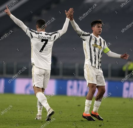 Juventus' Cristiano Ronaldo (L) celebrates his goal with teammate Paulo Dybala during the UEFA Champions League group G match between Juventus and Ferencvaros in Turin, Italy, Nov. 24, 2020.