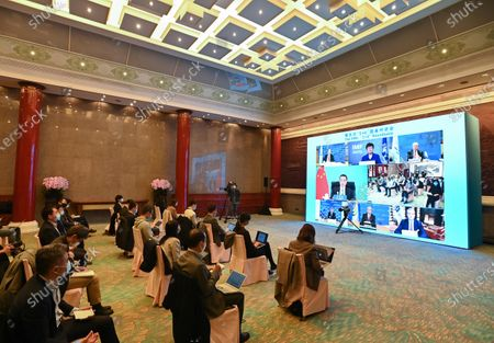 "Chinese Premier Li Keqiang and leaders of six major international economic institutions jointly meet the press via video link after the fifth ""1+6"" Roundtable, in Beijing, on Nov. 24, 2020."