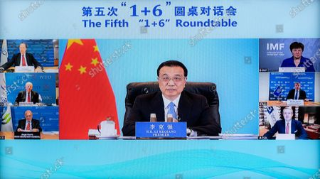 "Chinese Premier Li Keqiang holds the fifth ""1+6"" Roundtable with leaders of six major international economic institutions via video link, in Beijing, on Nov. 24, 2020."