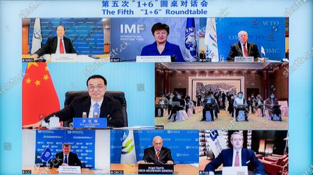 "Stock Picture of Chinese Premier Li Keqiang and leaders of six major international economic institutions jointly meet the press via video link after the fifth ""1+6"" Roundtable, in Beijing, on Nov. 24, 2020."