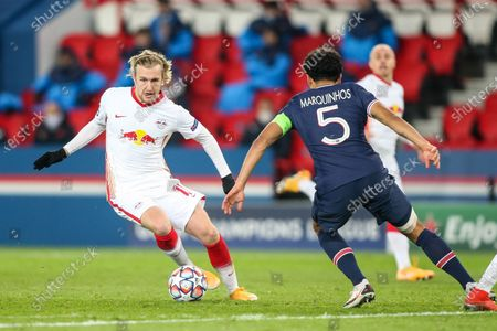 Leipzig's Emil Forsberg drives the ball pressured by PSG's captain Marquinhos (C) during the UEFA Champions League Group H second-leg football match between Paris Saint-Germain (PSG) and RB Leipzig