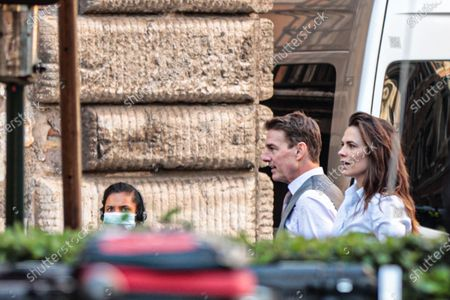 Tom Cruise and Hayley Atwell on set during film shooting of 'Mission Impossible 7' in the streets of the Ghetto of Rome