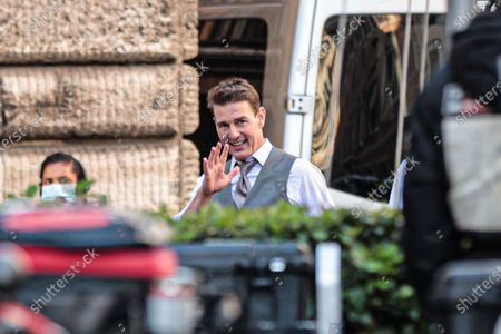 Tom Cruise greets the fans on set during film shooting of 'Mission Impossible 7' in the streets of the Ghetto of Rome