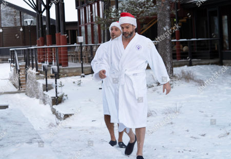 Gino D'Acampo and Fred Sirieix walk through the snow in dressing gowns as he heads for a sauna