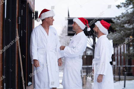 Gordon Ramsay, Gino D'Acampo and Fred Sirieix walk through the snow in dressing gowns as he heads for a sauna