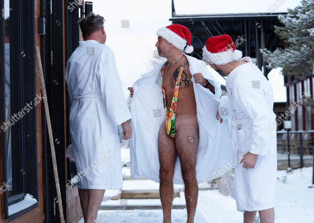 Gino D'Acampo (centre) reveals his mankini outfit to a surprised Gordon Ramsay and Fred Sirieix as they head into a sauna