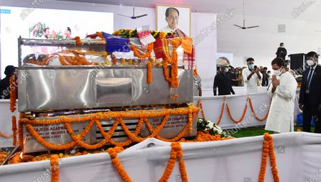 Stock Image of Congress leader Rahul Gandhi (C) paying tribute to former Assam Chief Minister Tarun Gogoi who died after facing post Covid-19 coronavirus complications, at Sankerdev Kalakhetra in Guwahati, Assam, India, 25 November 2020. Former Assam Chief Minister and veteran Congress leader Tarun Gogoi died on 23 November 2020.