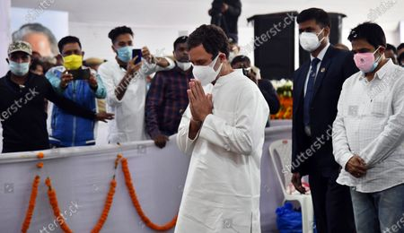 Stock Photo of Congress leader Rahul Gandhi (C) paying tribute to former Assam Chief Minister Tarun Gogoi who died after facing post Covid-19 coronavirus complications, at Sankerdev Kalakhetra in Guwahati, Assam, India, 25 November 2020. Former Assam Chief Minister and veteran Congress leader Tarun Gogoi died on 23 November 2020.