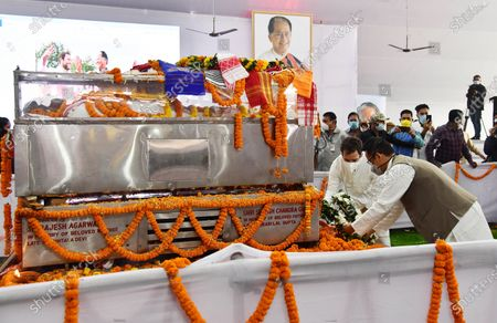 Congress leader Rahul Gandhi (in white) along with Gaurav Gogoi son Tarun Gogoi paying tribute to former Assam Chief Minister Tarun Gogoi who died after facing post Covid-19 coronavirus complications, at Sankerdev Kalakhetra in Guwahati, Assam, India, 25 November 2020. Former Assam Chief Minister and veteran Congress leader Tarun Gogoi died on 23 November 2020.