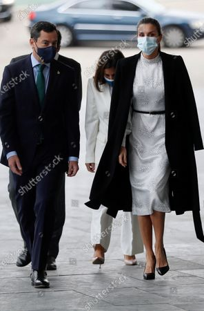 Queen Letizia of Spain (R) arrives to the opening of the Tourism Innovation Summit 2020 (TIS) next to regional President of Andalusia Juanma Moreno (L) held at the Exhibition and Congress Palace in Seville, Spain, 25 November 2020.  The TIS is an international forum tat gathers Tourism industry to define strategies and give a coordinate response for the sector's recovery in 2021. According to the Spanish Royal Household, King Felipe VI was not able to attend the opening as he has to keep a ten day quarantine after being in contact with a coronavirus positive some days ago.