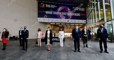 Queen Letizia of Spain (C) attends the opening of the Tourism Innovation Summit 2020 (TIS) next to regional President of Andalusia Juanma Moreno (2L), the Mayor of Seville Juan Espadas (R) and other authorities at the Exhibition and Congress Palace in Seville, Spain, 25 November 2020.The TIS is an international forum tat gathers Tourism industry to define strategies and give a coordinate response for the sector's recovery in 2021. According to the Spanish Royal Household, King Felipe VI was not able to attend the opening as he has to keep a ten day quarantine after being in contact with a coronavirus positive some days ago.