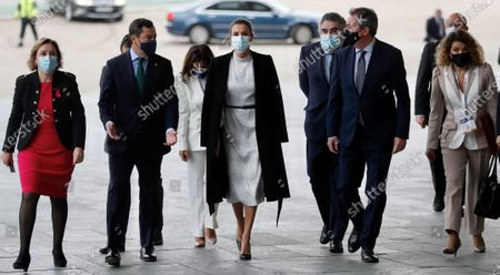 Queen Letizia of Spain (R) arrives to the opening of the Tourism Innovation Summit 2020 (TIS) next to regional President of Andalusia Juanma Moreno (2L) and the Mayor of Seville, Juan Espadas (2R), held at the Exhibition and Congress Palace in Seville, Spain, 25 November 2020. The TIS is an international forum tat gathers Tourism industry to define strategies and give a coordinate response for the sector's recovery in 2021. According to the Spanish Royal Household, King Felipe VI was not able to attend the opening as he has to keep a ten day quarantine after being in contact with a coronavirus positive some days ago.