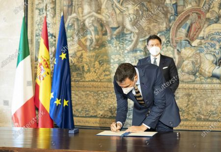 A handout photo made available by Palazzo Chigi Press Office shows Italian Premier, Giuseppe Conte (back), and his Spanish counterpart, Pedro Sanchez (front), during an Italy-Spain summit at L' Almudaina Palace, in Palma de Mallorca, Spain, 25 November 2020.