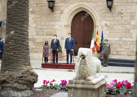 A handout photo made available by Palazzo Chigi Press Office shows Italian Premier, Giuseppe Conte (C-L), and his Spanish counterpart, Pedro Sanchez (C-R), during an Italy-Spain summit at L' Almudaina Palace, in Palma de Mallorca, Spain, 25 November 2020.