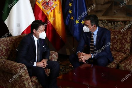 A handout photo made available by the Spanish Prime Minister's Office shows Spanish Prime Minister Pedro Sanchez (R) and Italian President Giuseppe Conte (L) meeting during the 14th Italian-Spanish summit at Almudaina Palace in Palma de Mallorca, Spain, 25 November 2020, where they are both chairing the 14th Italian-Spanish Summit to reinforce the alliances amongst both countries and to defend their common goals within the European Union.