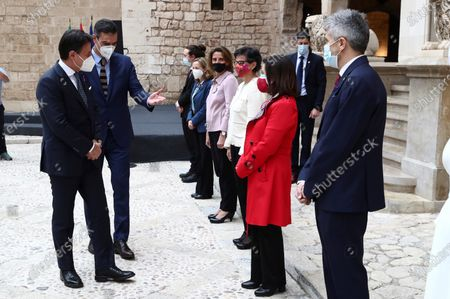 A handout photo made available by the Spanish Prime Minister's Office shows Spanish Prime Minister Pedro Sanchez (2L) and Italian President Giuseppe Conte (L) greeting Spanish Ministers as they arrive to attend the 14th Italian-Spanish summit at Almudaina Palace in Palma de Mallorca, Spain, 25 November 2020, where they are both chairing the 14th Italian-Spanish Summit to reinforce the alliances amongst both countries and to defend their common goals within the European Union.