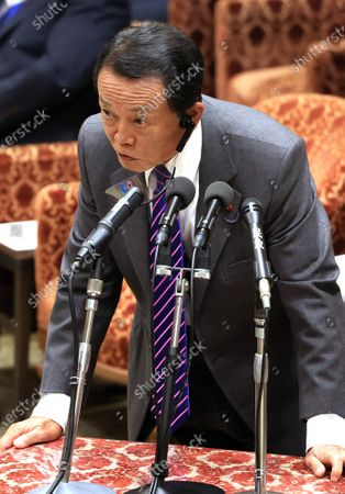 Japanese Finance Minister Taro Aso answers a question at Lower House's budget committee session at the National Diet in Tokyo on Wednesday, November 25, 2020.