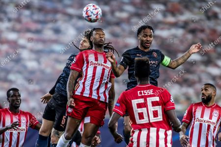 Olympiacos's Rúben Semedo (L) vies for the ball with Manchester City's Raheem Sterling