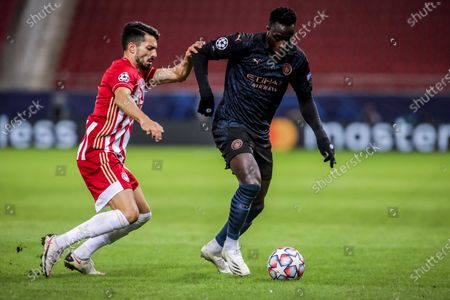 Manchester City's Benjamin Mendy (R) vies for the ball with Olympiacos's Pedro Rodrigues