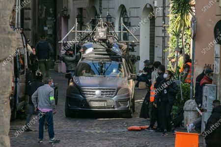 A film crew on the set filming Mission Impossible 7 Libra in the streets of Rome starring Tom Cruise and Haley Atwell