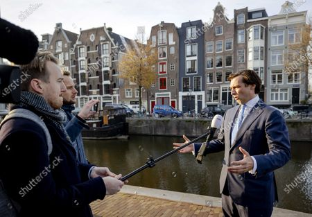 Thierry Baudet (R) of right-wing populist party Forum for Democracy speaks to the press outside his home in Amsterdam, The Netherlands, 25 November 2020. Baudet has not been expelled from the right wing populist Forum for Democracy party board, but board members have asked him to step down from the board.