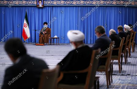 Iran's Supreme Leader Ayatollah Ali Khamenei shows Khamenei (C) speaking to president Hassan Rouhani (R) during a meeting with Iranian government over the economic crisis in Tehran, while mask-clad due to the Covid-19 coronavirus pandemic.