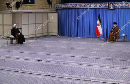 Iran's Supreme Leader Ayatollah Ali Khamenei shows Khamenei (R) speaking to president Hassan Rouhani (L) during a meeting with Iranian government over the economic crisis in Tehran, while mask-clad due to the Covid-19 coronavirus pandemic.