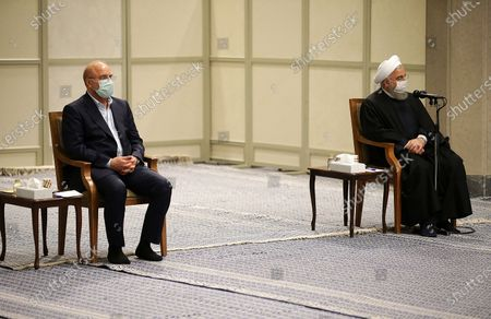 Iran's Supreme Leader Ayatollah Ali Khamenei on November 24, 2020 shows president Hassan Rouhani (R) and parliament speaker Mohammad Bagher Ghalibaf (L) attending a government meeting with Khamenei (unseen) over the economic crisis in Tehran, while mask-clad due to the Covid-19 coronavirus pandemic.