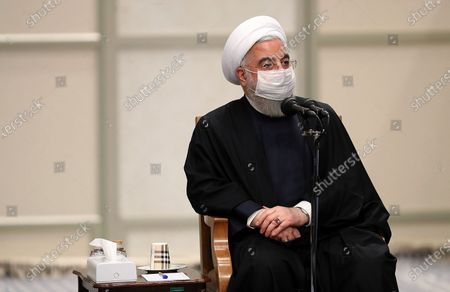 Iranian president Hassan Rouhani attend a government meeting with Iran's Supreme Leader Ayatollah Ali Khamenei (unseen) over the economic crisis in Tehran, while mask-clad due to the Covid-19 coronavirus pandemic.