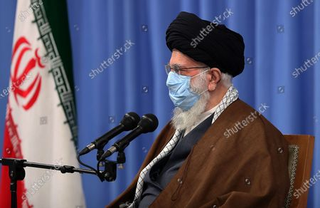 Stock Photo of Iran's Supreme Leader Ayatollah Ali Khamenei, as he speaks during a meeting with Iranian government over the economic crisis in Tehran, while mask-clad due to the Covid-19 coronavirus pandemic.