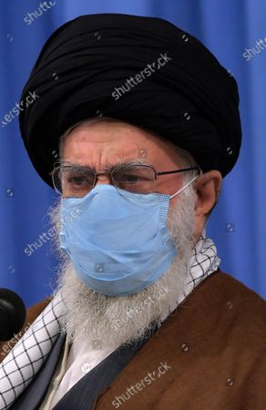Iran's Supreme Leader Ayatollah Ali Khamenei, as he speaks during a meeting with Iranian government over the economic crisis in Tehran, while mask-clad due to the Covid-19 coronavirus pandemic.