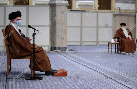 Stock Image of Iran's Supreme Leader Ayatollah Ali Khamenei, as he speaks during a meeting with Iranian government over the economic crisis in Tehran, while mask-clad due to the Covid-19 coronavirus pandemic.