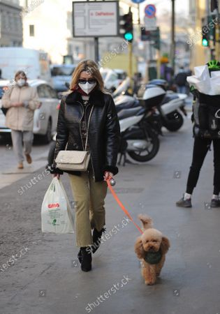 "Stock Photo of Elena Barolo walks through the streets of the center with her inseparable little dog, a ""toy"" called Wisky, before returning home a stop at the pharmacy."
