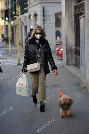 "Stock Image of Elena Barolo walks through the streets of the center with her inseparable little dog, a ""toy"" called Wisky, before returning home a stop at the pharmacy."