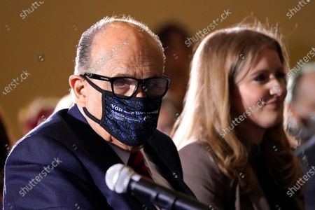 Former Mayor of New York Rudy Giuliani, a lawyer for President Donald Trump, wears a face mask to protect against COVID-19 after speaking at a hearing of the Pennsylvania State Senate Majority Policy Committee, in Gettysburg, Pa